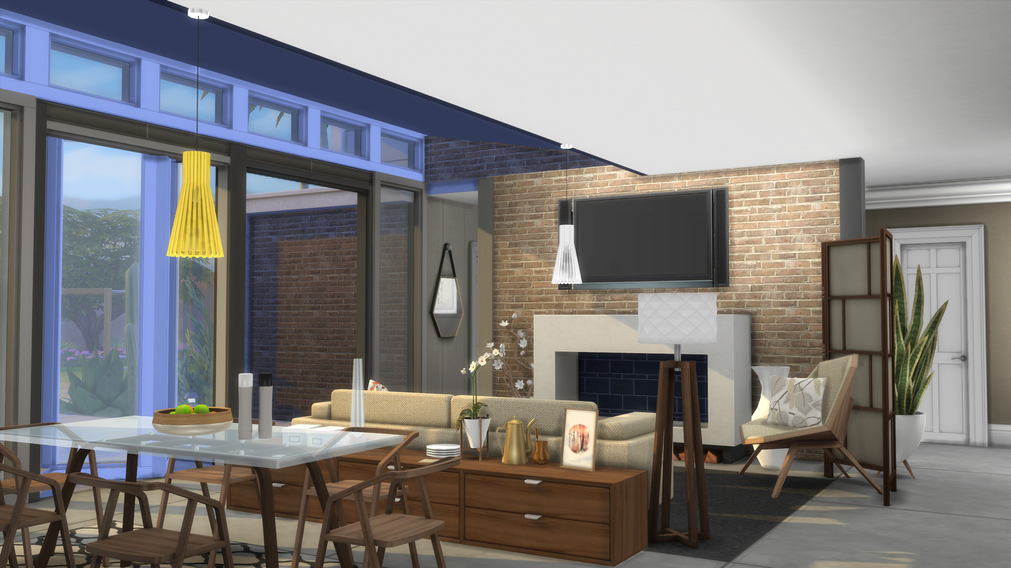 The bi fold sliding doors and semi vaulted ceiling of the living area offer definitive modern flair to the space